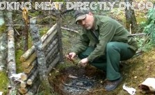 Outdoors Cooking Meat Directly On Coals